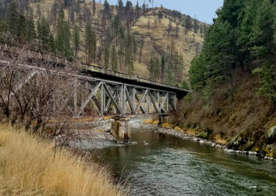 idaho railroad bridge over a river surrounded by mountains