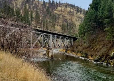 old railroad bridge over Idaho stream