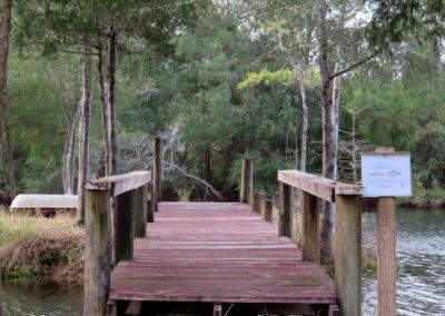 rustic wooden pier on cedar lake in milton, tx